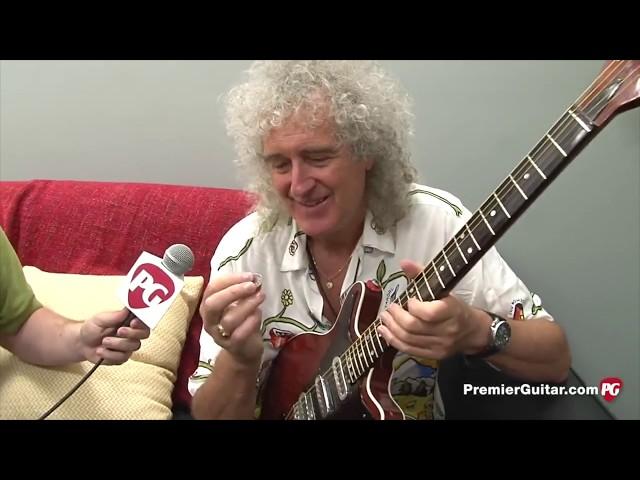 como tocar la guitarra con una moneda como Brian May de Queen